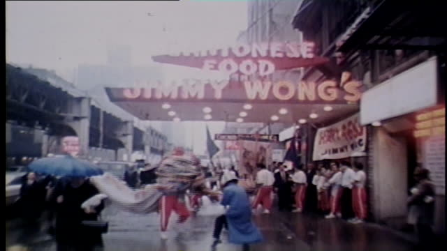 wgn chinese new year's celebration outside cantonese food jimmy wong's restaurant with a sign that reads happy 4666 in chicago in 1968 - chinatown stock videos & royalty-free footage