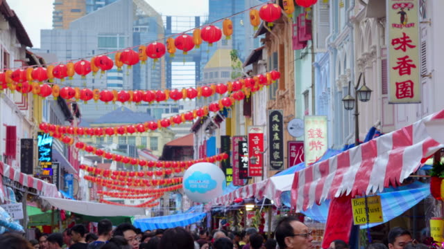 chinese new years in singapore china town and traveller enjoy traviling (ed) - chinatown stock videos & royalty-free footage
