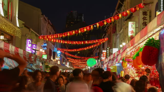 chinese new years in singapore china town and traveller enjoy traviling (ed) - street market stock videos & royalty-free footage
