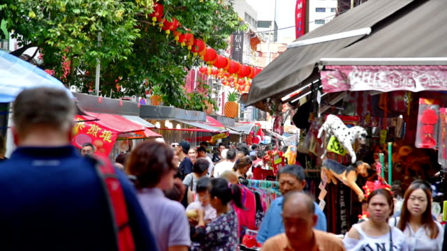 chinese new years in singapore china town and traveller enjoy traviling - chinatown stock videos & royalty-free footage
