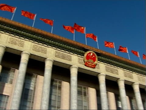 chinese parliament building / wen jiabao speech in great hall of the people china beijing ext various good shots of red chinese flags flying on top... - headdress stock videos & royalty-free footage