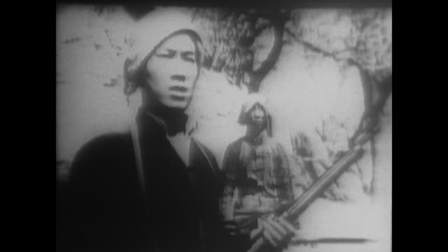 chinese peasant guerillas use tricks and traps to wage resistance against japan including hiding underground fully armed - 1938年点の映像素材/bロール