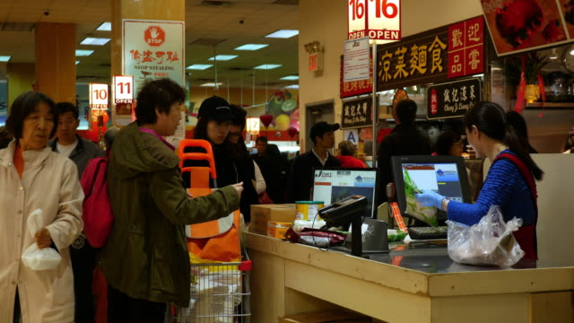 Chinese people shopping at grocery in Flushing, Queens, New York City