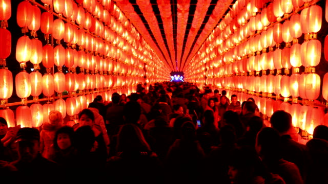 chinese people visits a lantern show for the chinese lantern festival on february 11 2017 in zhangjiakou china china celebrates the traditional... - lantern stock videos & royalty-free footage