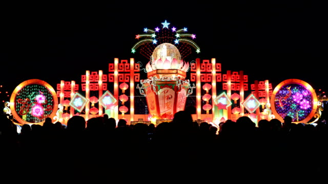 chinese people visits a lantern show for the chinese lantern festival on february 11, 2017 in zhangjiakou, china. china celebrates the traditional... - chinesisches laternenfest stock-videos und b-roll-filmmaterial
