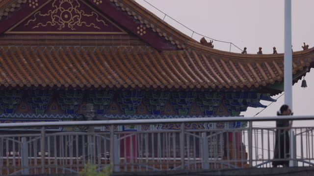 chinese people (unidentified) walking by a local temple building,shanghai,china - pagoda stock videos & royalty-free footage