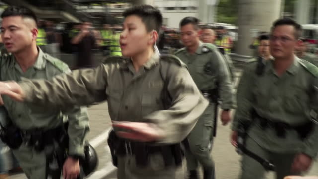 chinese police attempting to push back crowds of protesters in hong kong - pushing stock videos & royalty-free footage