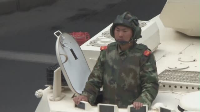 chinese police shoot dead four people who allegedly attacked a communist party office in the restive xinjiang region in the bloodiest such incident... - communist party stock videos and b-roll footage