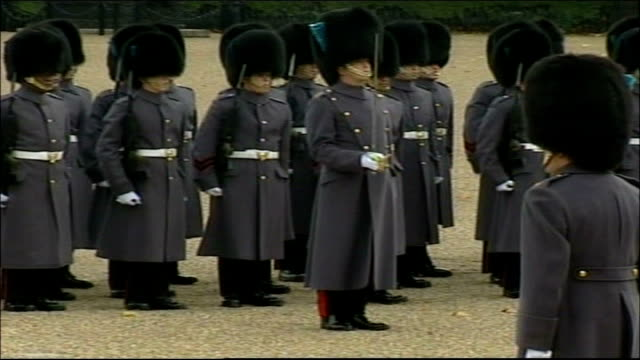 chinese president hu jintao state visit: hu jintao greeted by queen and politicians; england: london: horse guards parade: ext soldiers parading in... - cavalry stock videos & royalty-free footage
