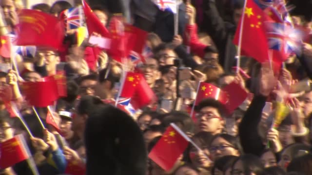 chinese president state visit to britain; england: london: ext pro-china supporters with chinese and uk flags chanting 'pro china love uk' sot crowds... - human back stock videos & royalty-free footage