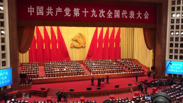chinese president xi jinping attends the closing session of the 19th national congress of the communist party of china at the great hall of the... - comunismo video stock e b–roll