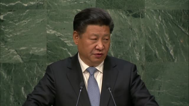 chinese president xi jinping speaks during the opening of the 70th session of the united nations general assembly at the un headquarters in new york... - 国際連合点の映像素材/bロール