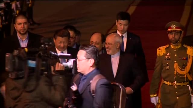 chinese president xi jinping was welcomed by iranian foreign minister mohammad javad zarif upon his arrival at mehrabad international airport in iran... - foreign minister stock videos and b-roll footage