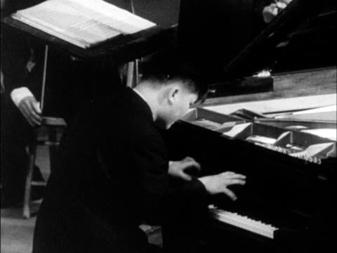 chinese produced cultural survey of 1962 china - pianist stock videos & royalty-free footage