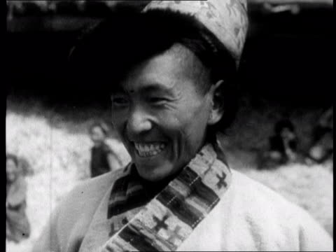 chinese propaganda film on tibet made one year after the dalai lama fled to india in 1959 - altruismo video stock e b–roll