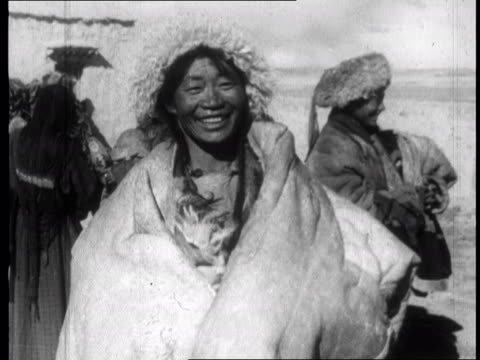 chinese propaganda film on tibet made one year after the dalai lama fled to india in 1959 - tibet stock videos & royalty-free footage