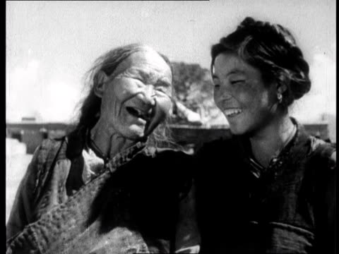 chinese propaganda film on tibet made one year after the dalai lama fled to india in 1959 - traditional clothing stock videos & royalty-free footage