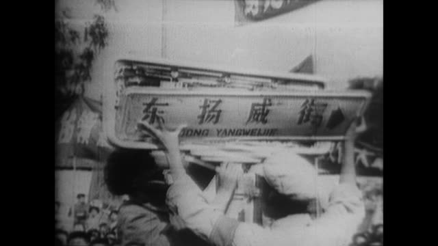 chinese red guards set fire to, take down and destroy all signs and images of capitalism from the streets during the cultural revolution as... - customs stock videos & royalty-free footage