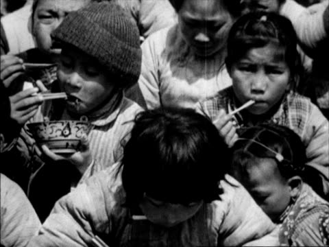 chinese refugees fleeing and orphans being fed rice / mass migration of citizens fleeing destruction - porcelain stock videos & royalty-free footage