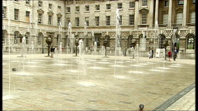 chinese regime denounced by british artists as ai weiwei exhibition opens location unknown somerset house ext general views of bronze animal head... - courtyard stock videos and b-roll footage