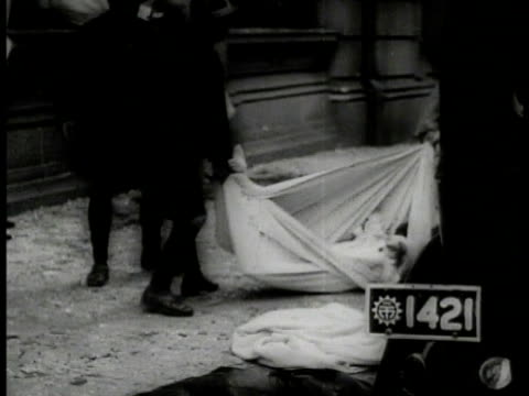 chinese running on street panic fear la ws silhouette of soldiers on rooftop graphic vs bombed shanghai streets dead bodies debris injured people... - 1937 stock videos and b-roll footage
