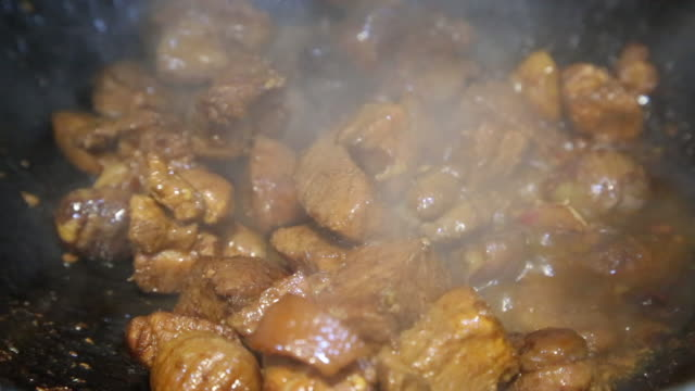chinese sauce braised meat - braised stock videos and b-roll footage