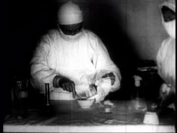 vídeos de stock, filmes e b-roll de chinese scientists creating glass slides and examining specimens in viral and biological laboratories looking for cholera and plague - artigos de vidro de laboratório