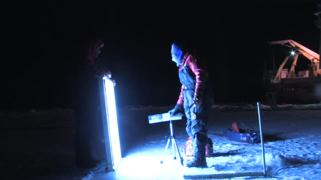 chinese scientists take measurements in the arctic darkness september 27 2008 – from the historic 17month expedition involving 250 scientists from 26... - climate scientist stock videos & royalty-free footage