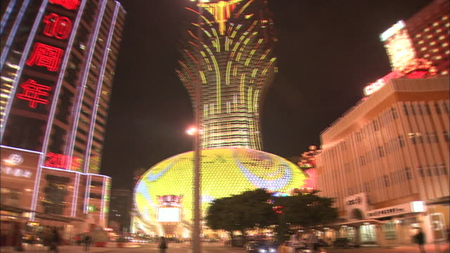 chinese script is written in neon light on the facade of a casino in macao, china. - chinese script stock videos & royalty-free footage