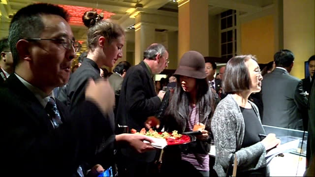 chinese seal carving and calligraphy exhibition british museum mrs zhao shaohua speaking sot crowd eating from platters / various shots carvings and... - carving food stock videos and b-roll footage