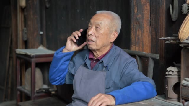 chinese senior man using mobile phone - chinese culture stock videos & royalty-free footage
