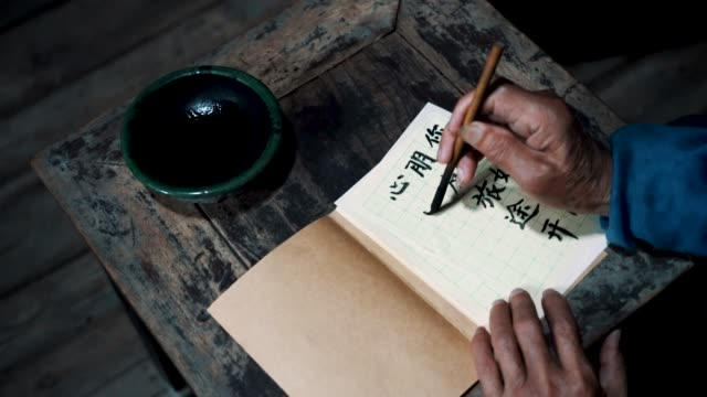 chinese senior man writing chinese calligraphy - non western script stock videos & royalty-free footage