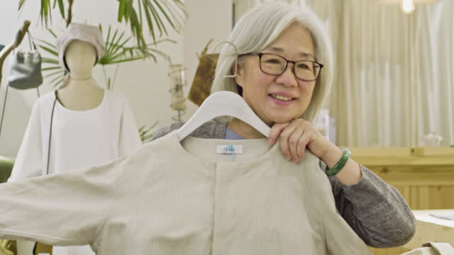 "chinese senior woman shopping for new clothes - xavierarnau or ""xavier arnau serrat"" stock videos & royalty-free footage"