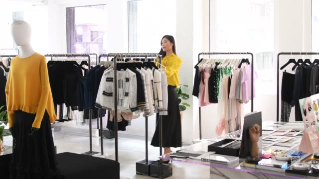 chinese shop assistant working in fashion boutique - department store stock videos & royalty-free footage
