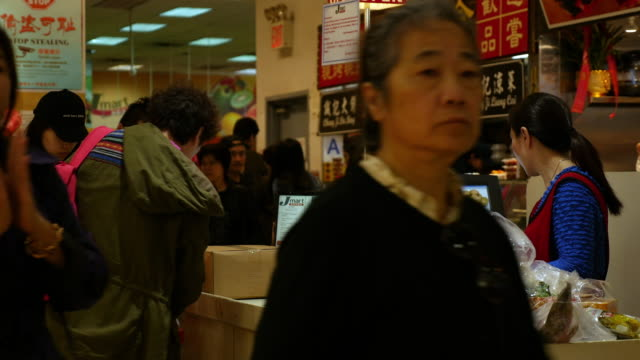 chinese shopping at food grocery in flushing, queens, new york city - container video stock e b–roll
