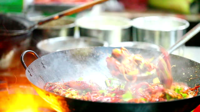 Chinese small lobster stir frying in the kitchen