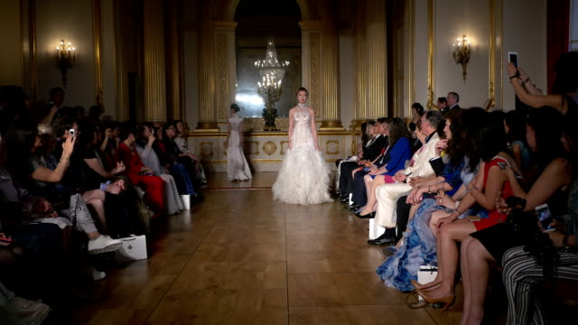 Chinese socialite Rachel Yao on Grace Chen fashion catwalk show at Lancaster House London on June 11 2016