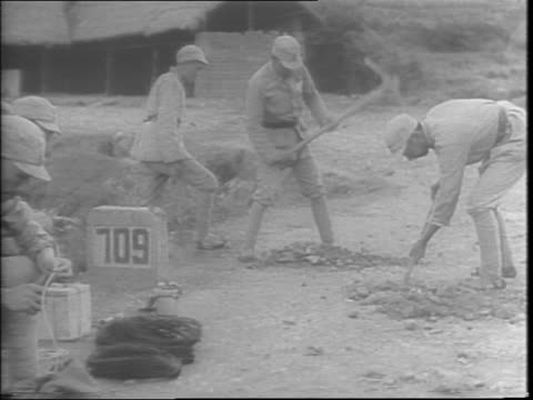 chinese soldiers, some on stretchers and stricken with malaria and war injuries, are being cared for by women / soldiers dig captured sections of... - 1943 stock videos & royalty-free footage