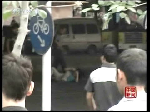 chinese state media reports over 100 people have been killed in riots in china's restive xinjiang region. urumqi, xinjiang, china. - 2009 stock videos & royalty-free footage