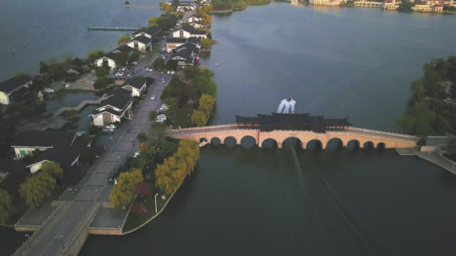 aerial ws chinese style arch bridge over jinji lake, ligongdi, suzhou, jiangsu province, china - arch bridge stock videos & royalty-free footage