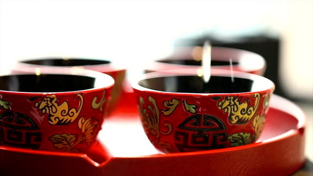 chinese tea ceremony cups in wedding day. - chinese tea cup stock videos and b-roll footage