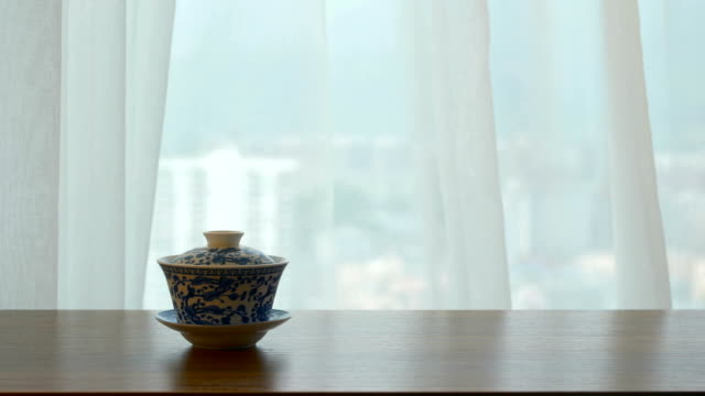 chinese tea cup on table by window - chinese tea cup stock videos and b-roll footage