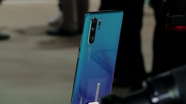 chinese technology giant huawei unviels its new p30 and p30 pro smart phone at a launch event at the porte de versailles paris expo centre in paris... - feature phone stock videos and b-roll footage