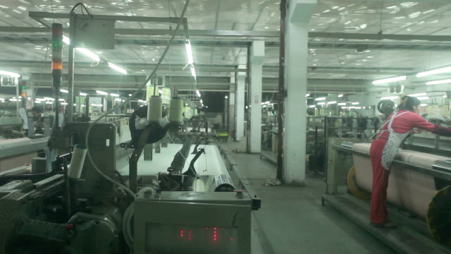 chinese textile factory interior and machines working scene - clothing stock videos & royalty-free footage