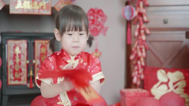 Chinese toddler girl celebrating Chinese new year at home