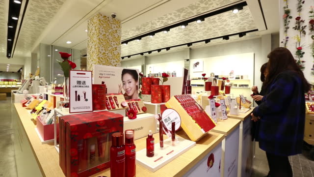 stockvideo's en b-roll-footage met chinese tourists browse cosmetics at amorepacific corp mamonde store in the myeongdong shopping district in seoul south korea on monday feb 16 2015 - korea