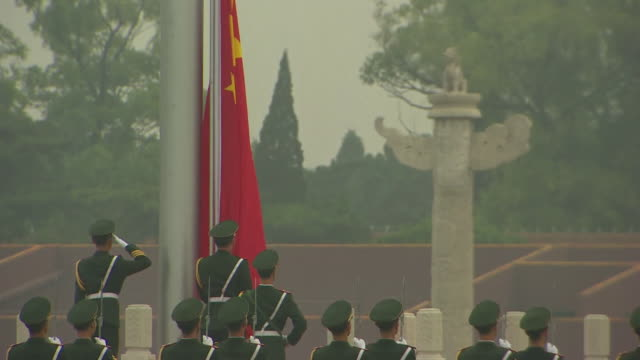 chinese troops stand to attention at flag raising ceremomy in tiananmen square beijing - chinese flag stock videos & royalty-free footage