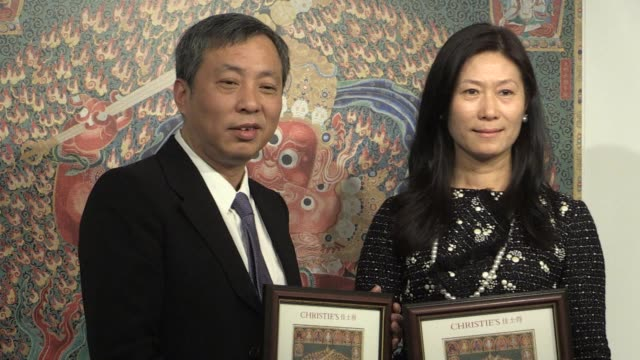 chinese tycoon liu yiqian is handed official ownership of his latest multi million art auction purchase a tibetan tapestry in hong kong saying it is... - tapestry stock videos & royalty-free footage