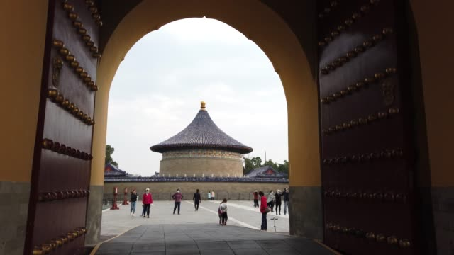 chinese visitors wear protective masks as they tour the grounds of the temple of heaven on april 17 2020 in beijing china - beijing stock videos & royalty-free footage