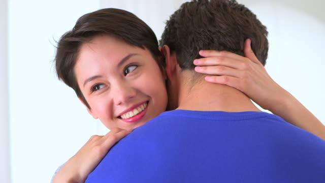 chinese woman happily in her boyfriend's arms - menschliches gelenk stock-videos und b-roll-filmmaterial